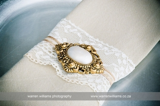 Vintage Wedding Décor Idea - Antique Brooch & Lace Napkin
