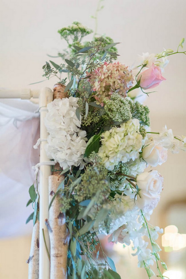 STUNNING floral arch decor in this Peach and Blush Autumn Wedding at the Tupper Manor by Kristen Jane Photography | Seen first on ConfettiDaydreams.com