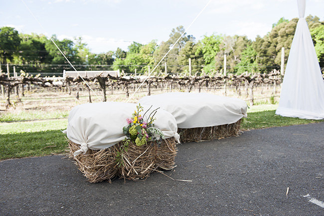 Hay Bales Wedding Decor :: Pale Yellow, White & Coral Winelands Destination Wedding (South Africa) :: Joanne Markland Photography :: ConfettiDaydreams.com Wedding Blog