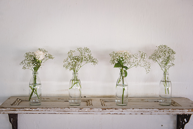 Babys breath in vintage bottles // Vintage Elegance Neutral South African Wedding //Lauren Kriedemann photography // via www.ConfettiDaydreams.com //