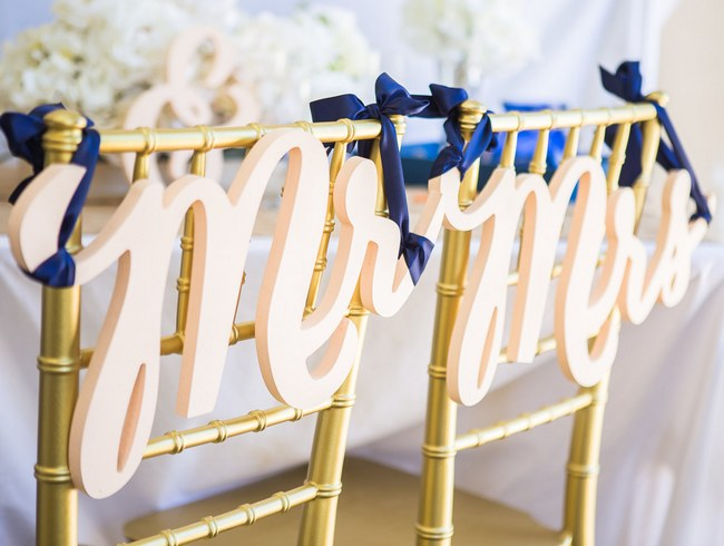 10 Adorably Fun Wedding Chair Signs & Covers for Bride and Groom