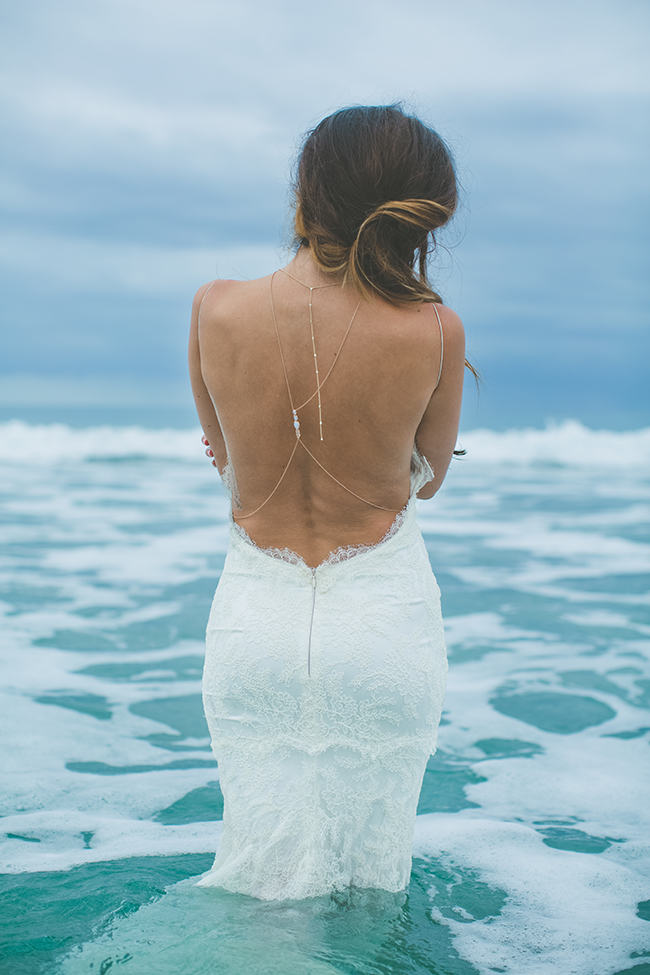 Stunning backless beach wedding dress by katie may for Backless beach wedding dresses