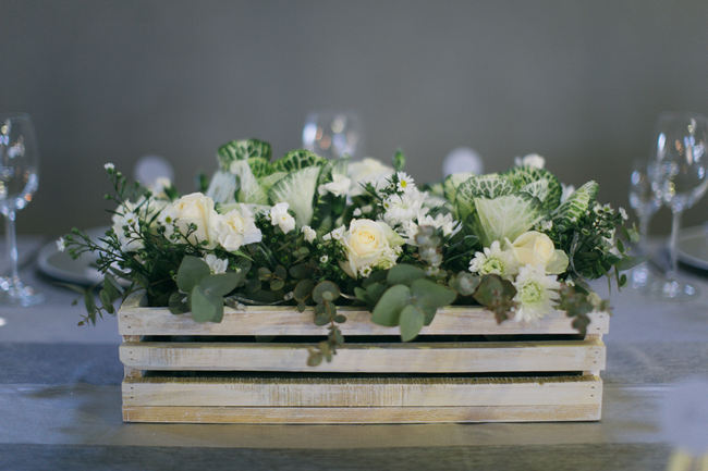 Flowers in crate //  Beautiful Gray and Yellow Rustic Winter Wedding Reception Decor / Jenni Elizabeth Photography