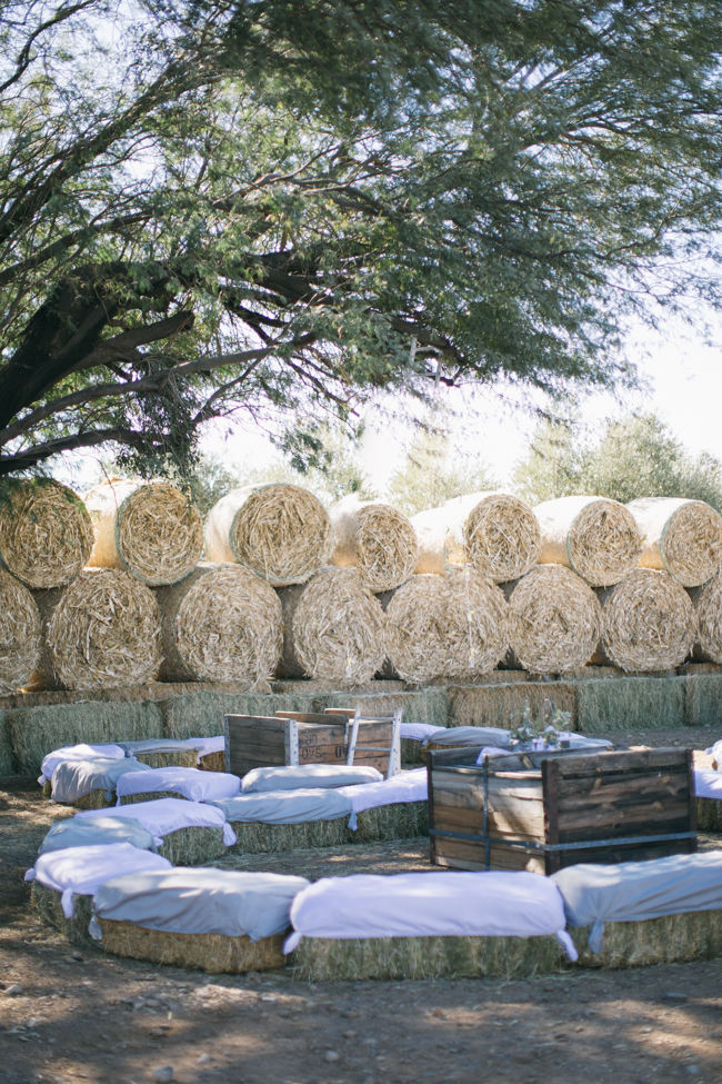Outdoor seating on hay bales //  Beautiful Gray and Yellow Rustic Winter Wedding Reception Decor / Jenni Elizabeth Photography