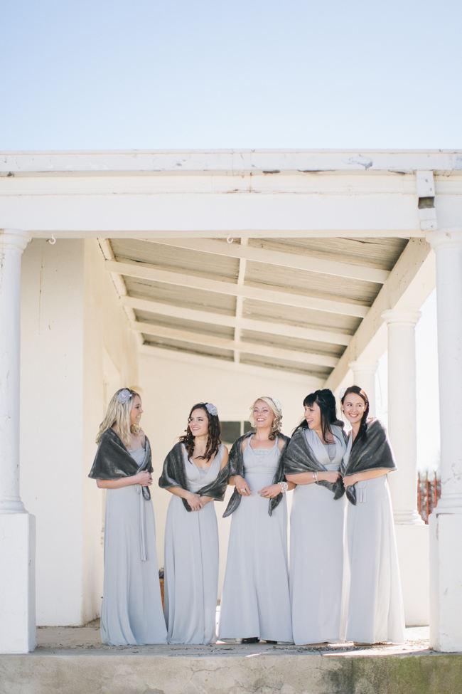 Grey Bridesmaid dresses with winter shrugs // Beautiful Gray and Yellow Winter Wedding / Jenni Elizabeth Photography