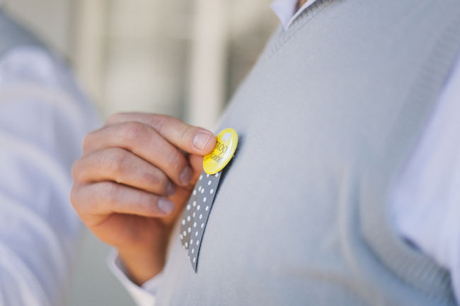 Grey groom pullover and yellow button // Beautiful Gray and Yellow Winter Wedding / Jenni Elizabeth Photography