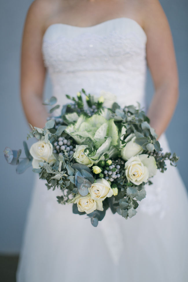 Rustic wedding bouquet from kale. yellow roses, brunia balls and eucalyptus