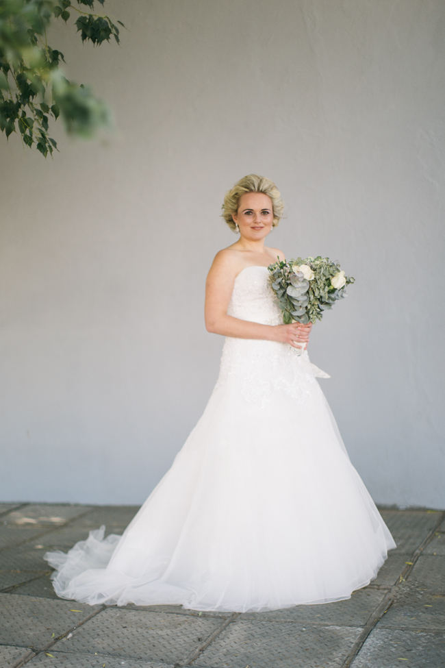 Delightful green and cream winter wedding bouquet // Beautiful Gray and Yellow Winter Wedding / Jenni Elizabeth Photography