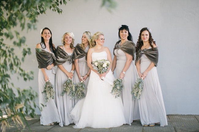 Grey Bridesmaid dresses with winter shrugs // Beautiful Gray and Yellow Winter Wedding / Jenni Elizabeth Photography