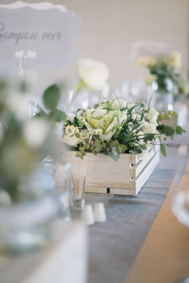 wooden crate with kale centerpiece //  Beautiful Gray and Yellow Rustic Winter Wedding Reception Decor / Jenni Elizabeth Photography