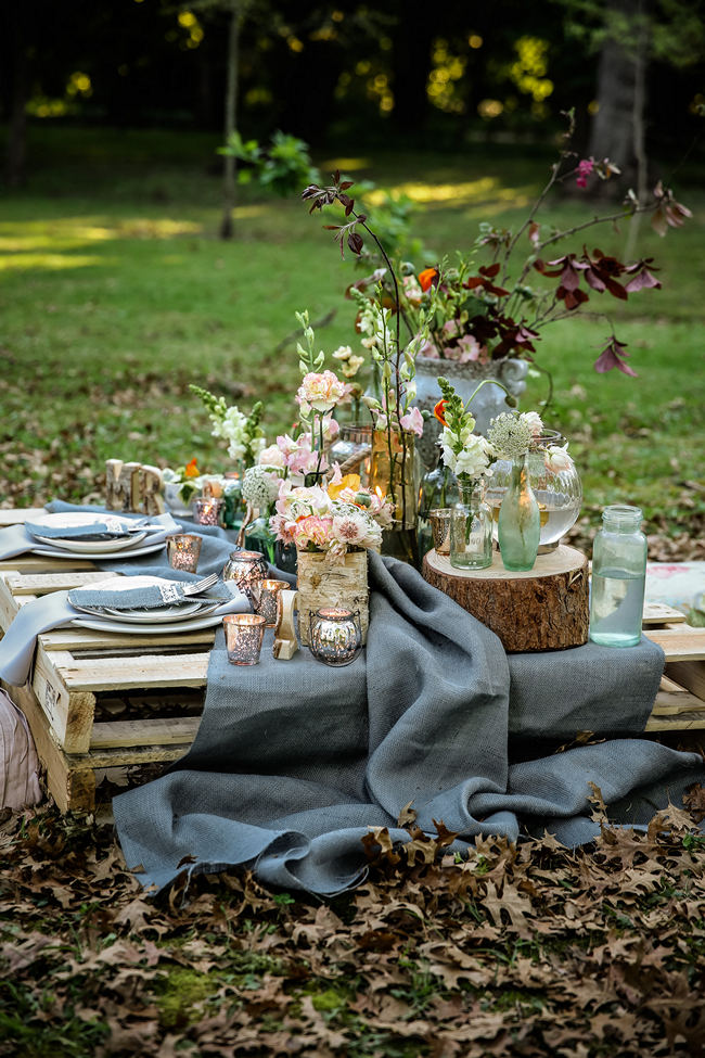 Rustic garden picnic wedding nikki meyer photography a pretty pallet picnic table using grey hessian burlap runner filled with rustic decor elements workwithnaturefo