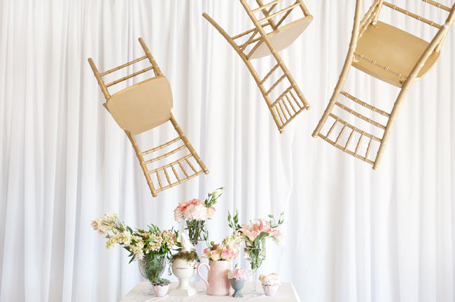Whimsical blush, Cream and Gold wedding flowers: Roses, blusing brides, carnations and lilies. Floating gold chairs. Pics by St Photography