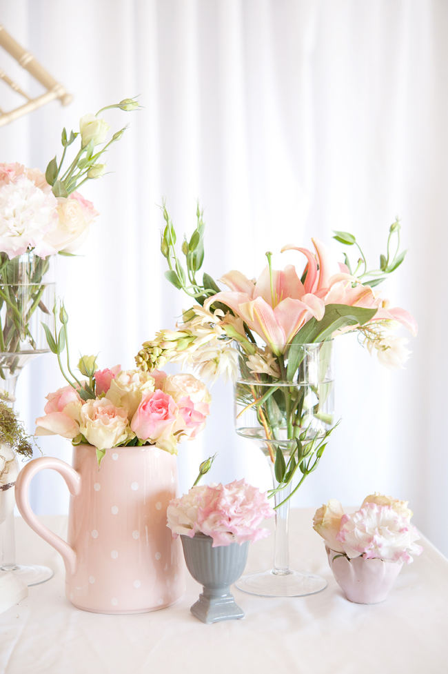 Pretty blush, Cream and Gold wedding flowers: Roses, blusing brides, carnations and lilies. Pics by St Photography