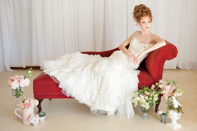 Love this delicate cream wedding dress with ruffles.