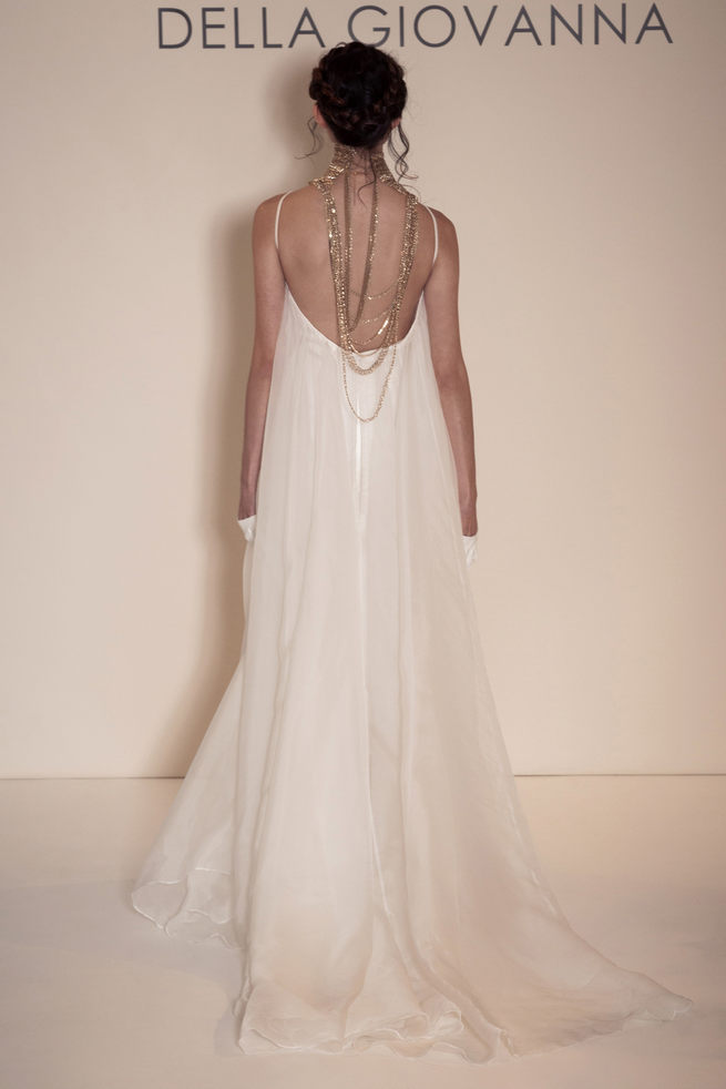 Relaxed, loose fitting wedding dress with gold necklace, chain style detail. Della Giovanna Wedding Dresses
