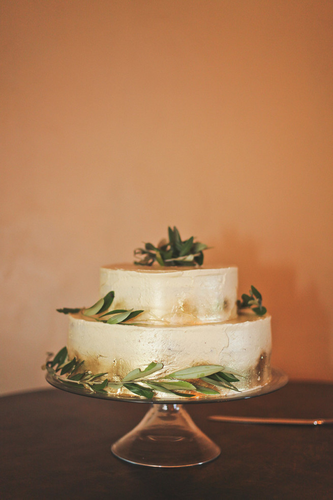 Two tiered gold dusted cake with leaves and laurels . Green White Rustic South African Wedding // Justin Davis Photography