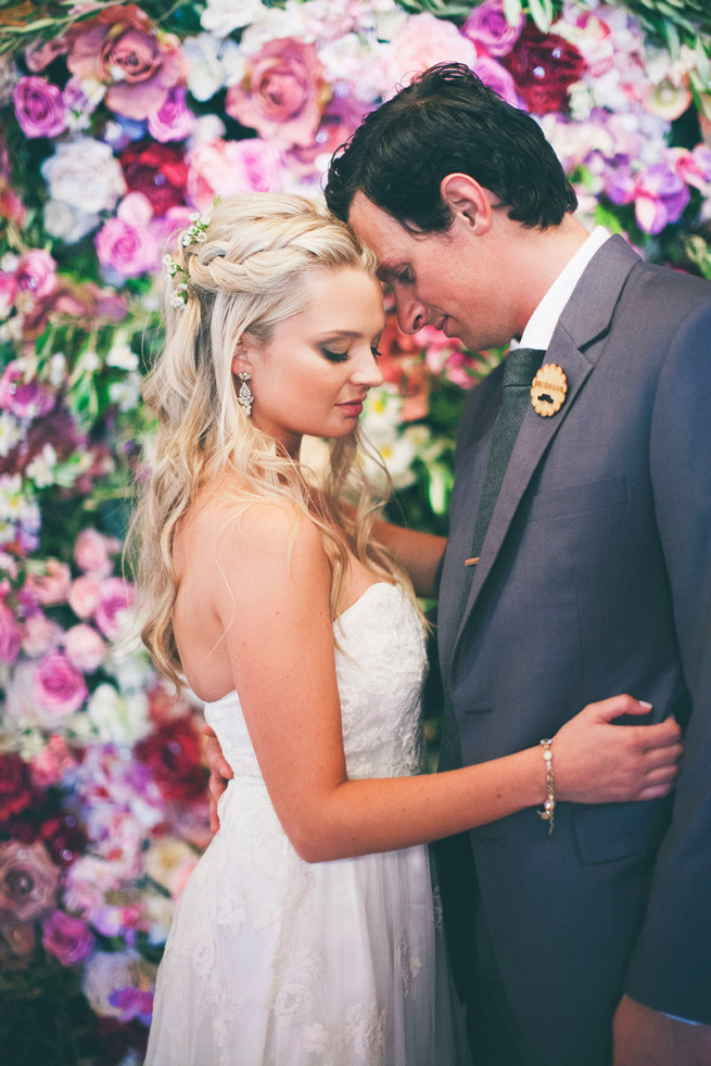 Long wedding hair idea. Groom in grey suit with grey tie. Green White Rustic South African Wedding // Justin Davis Photography