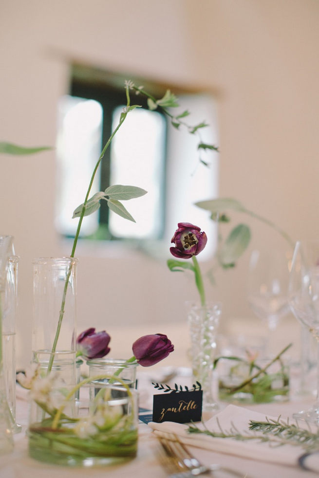 Single stem lavender and purple tulips in glass vases. Simple and effective. Gorgeous Navy Gold Wedding at Babylonstoren / Charlene Schreuder Photography