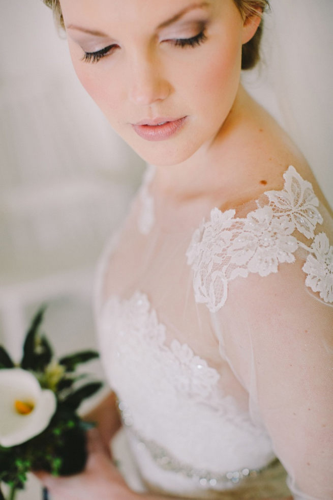 Exquisite bridal gown with sheer illusion sleeves and lace tattoo detail by Elizabeth Stockenstrom. Click to see the Navy Gold Wedding at Babylonstoren / Charlene Schreuder Photography