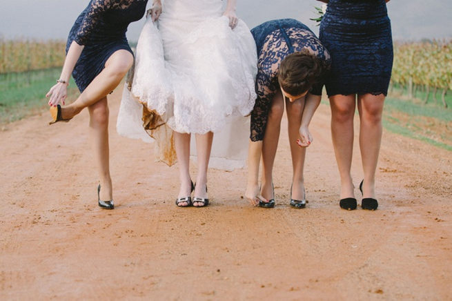 CUTE! Bridesmaids in short navy dresses with long lace sleeves