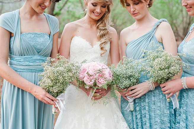 Bridesmaids wearing mismatched blue dress, with babys breath bouquet. Pink peony bridal bouquet. Blush Pink and Powder Blue Spring Wedding // D'amor Photography