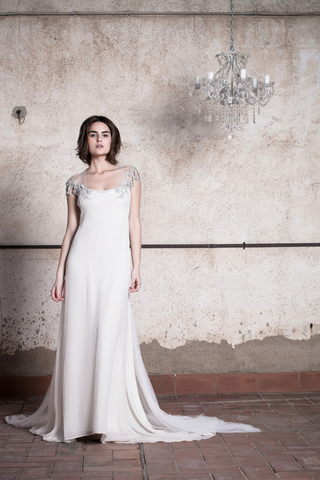 Delicate tulle and lace wedding dress with sheer lace cape sleeves // Ramon Herrerías Wedding Dresses
