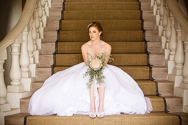 Beaded bodice and tulle skirt with King Protea wedding bouquet. Soft Pink and Gold Wedding by Samanatha Jackson Photo