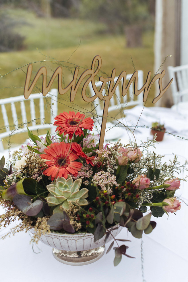Succulent centerpiece arrangement with lazer cut Mr and Mrs Sign // Succulent Garden Wedding // Claire Thomson Photography