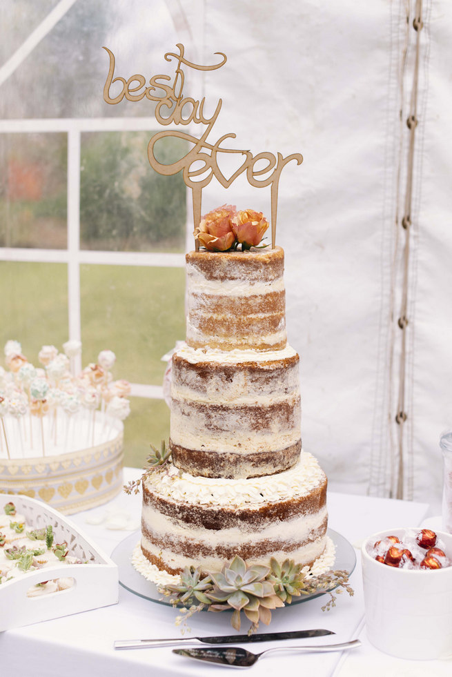 Stunning naked wedding cake decorated with succulents and laser cut wooden cake topper: Best Day Ever