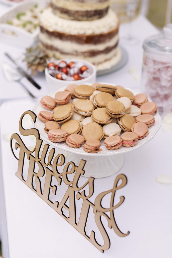 Lazer cut wood sign: Sweets and Treats with macarons on dessert buffet // Succulent Garden Wedding // Claire Thomson Photography