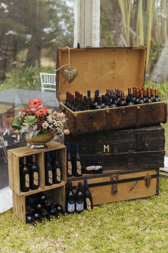 Rustic vintage suitcases and crates with drinks // Succulent Garden Wedding // Claire Thomson Photography