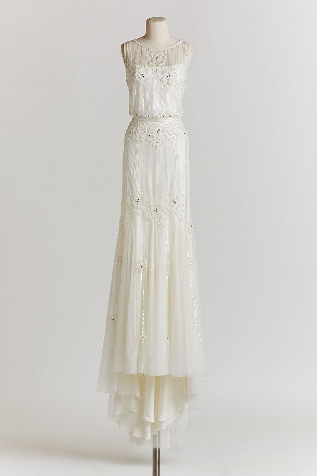 Vintage Wedding Dress: The Magnolia gown features a sheer neckline, and a layered skirt of delicate, gauzy tulle, in a beaded ivory fabric with a deep-v back