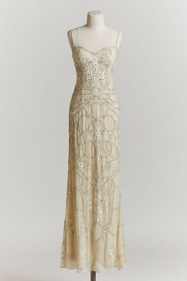 Art Deco Wedding Dress: this sleek, ivory shell features skinny straps and a sequin motif from shoulder to toe.