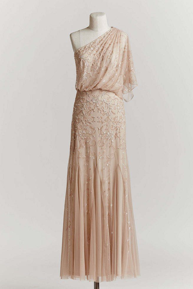 Vintage Wedding Dress in Blush: This soft blush gown with draped, off the shoulder sultriness is embellished with a vine-inspired pattern of sequinned and sparkle detailing. This lovely gown would also make a magnificent MOH gown, too!