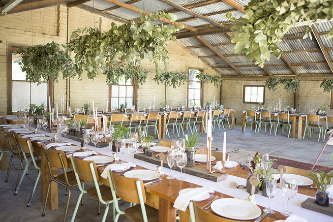 Long farmstyle tables with Gold candle holders and herb planters // // Organic Farm Style Karoo Wedding // christine Le Roux Photography