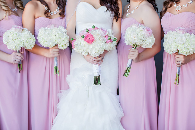 White bouquets and Bridesmaids wearing long blush strapless gowns // Modern Romance: Pink and Silver Wedding // Jessica Q Photography