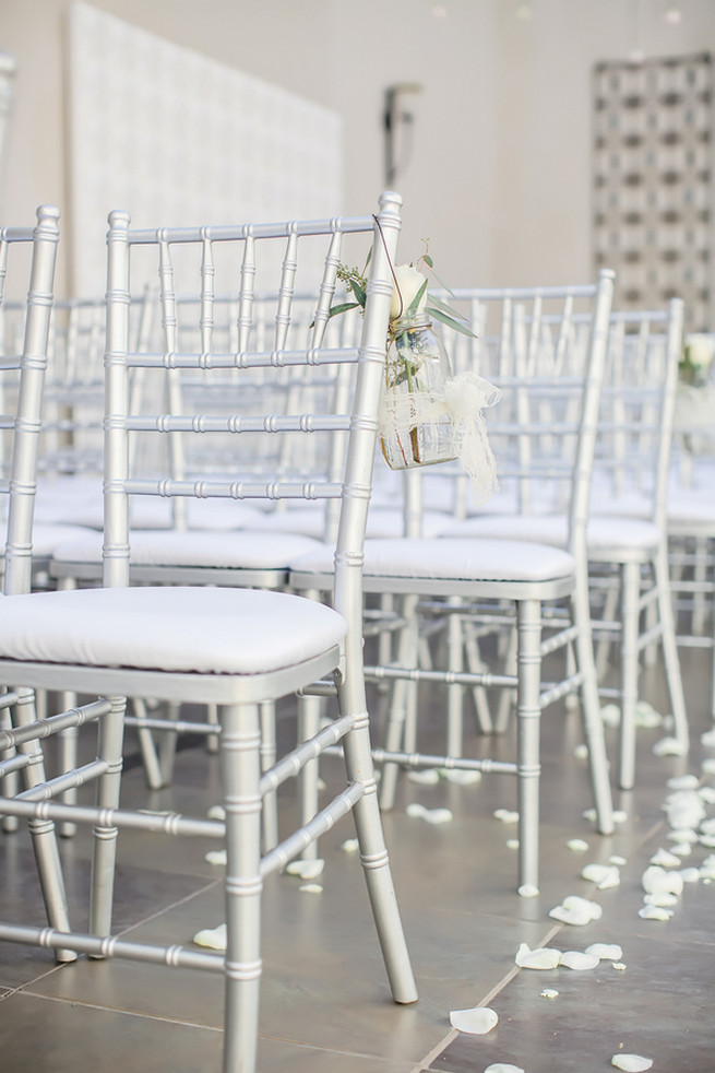 Silver wedding chairs with cream roses // Modern Romance: Pink and Silver Wedding // Jessica Q Photography