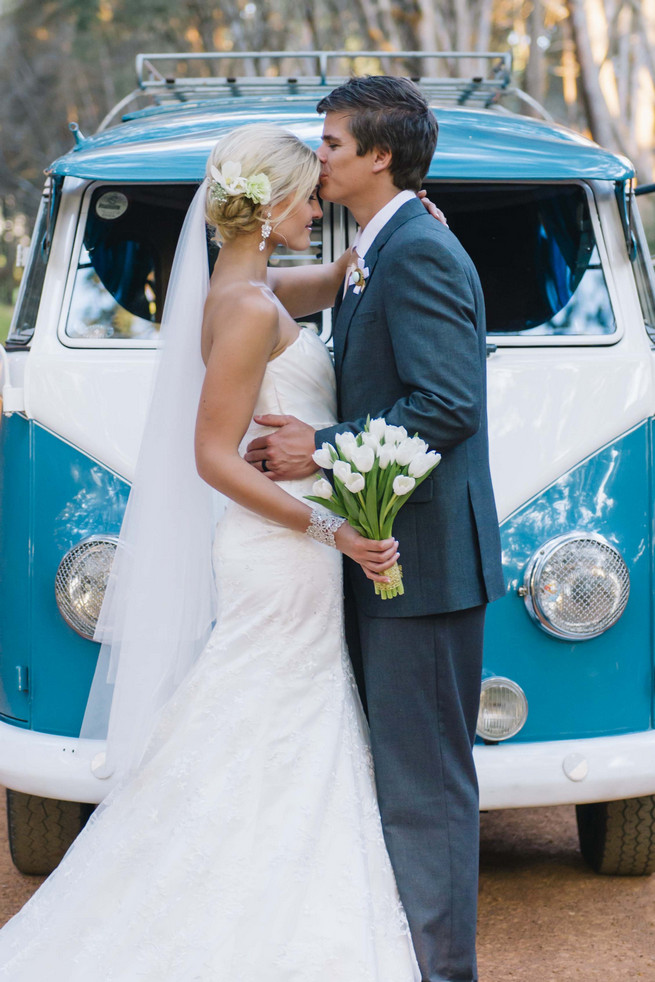 Couple photos in front of a vintage volkswagen van. ite and Gold DIY Chevron Wedding, South Africa, by Claire Thomson Photography
