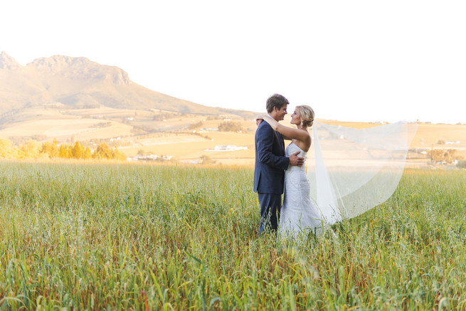 Fields of love. Couple photos in front of a vintage volkswagen van. ite and Gold DIY Chevron Wedding, South Africa, by Claire Thomson Photography