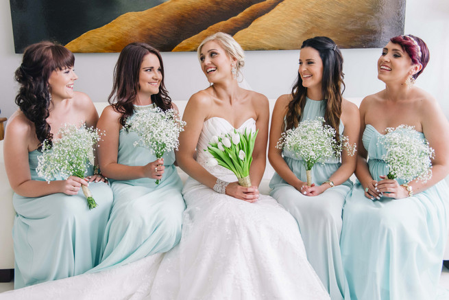 Bride and bridesmaids in mint gowns with babys breath bouquets. White and Gold DIY Chevron Wedding, South Africa, by Claire Thomson Photography