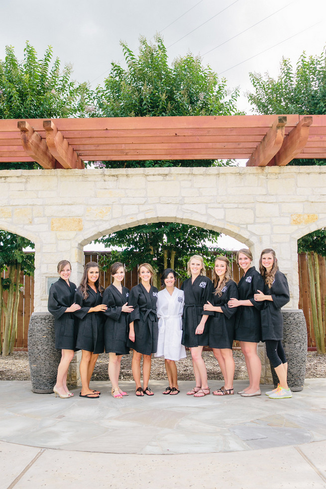 Bridesmaids in their monogrammed robes. Cute Coral Gray wedding at Briscoe Manor, Houston, by Luke and Cat Photography
