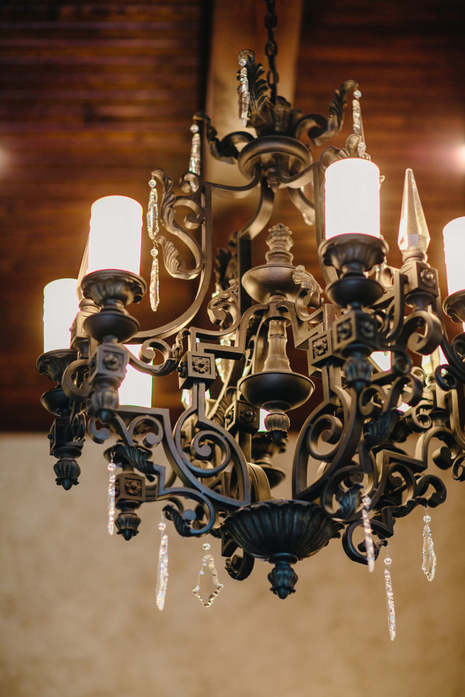 Black chandelier. Cute Coral Gray wedding at Briscoe Manor, Houston, by Luke and Cat Photography