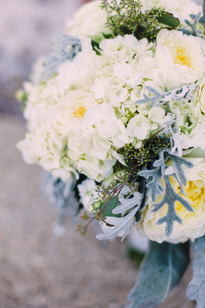 Romantic wedding bouquet of white hydrangea, white garden roeses, peony, dusty miller and lambs ear with white bouquet wrap. / Elegant Milwaukee Wedding Valo Photography