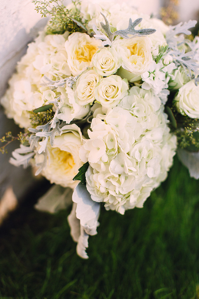 Romantic wedding bouquet of white hydrangea, white garden roeses, peony, dusty miller and lambs ear with white bouquet wrap. / Alyssa Kristin's Elegant Milwaukee Wedding Valo Photography