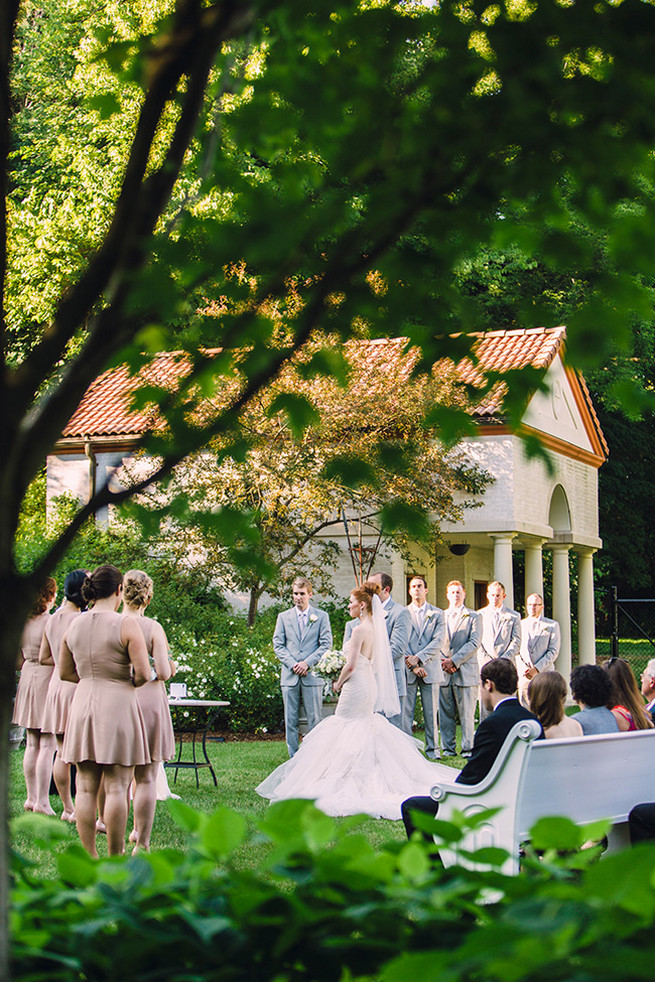 Outdoor garden wedding ceremony at Villa Terrace. / Alyssa Kristin's Elegant Milwaukee Wedding Valo Photography