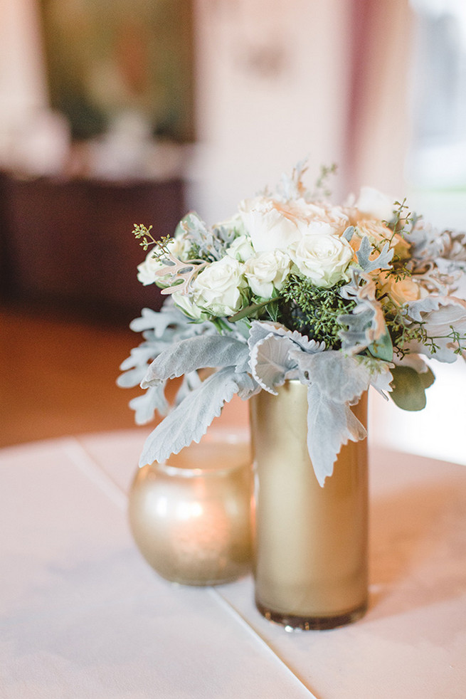 DIY painted gold vases with re-purposed bridesmaids bouquets of cream roses and dusty miller. / Elegant Milwaukee Wedding Valo Photography