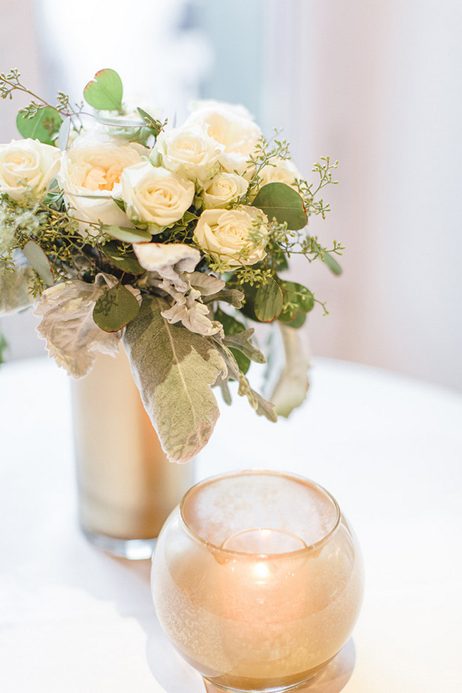 DIY painted gold vases with re-purposed bridesmaids bouquets of cream roses and dusty miller. / Alyssa Kristin's Elegant Milwaukee Wedding Valo Photography