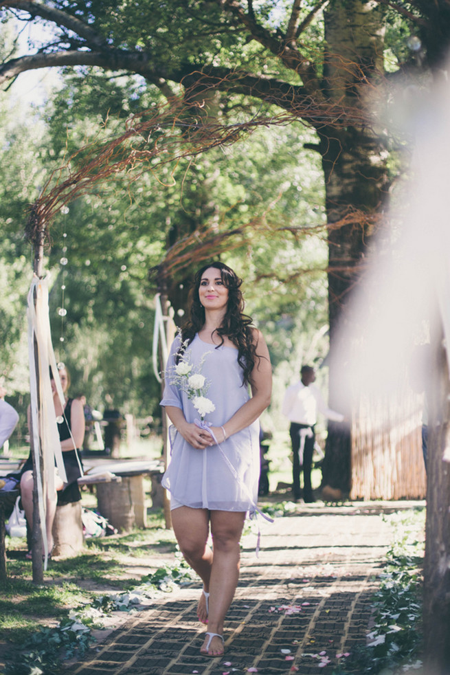 Bridesmaid in grey off the short short dress and three white flowers. Grey White Farm Wedding, South Africa // Maryke Albertyn