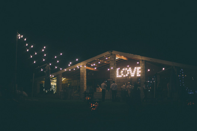 LOVE marquee sign with lights. Barn wedding with fairy lights and paper lanterns. Grey White Farm Wedding, South Africa // Maryke Albertyn