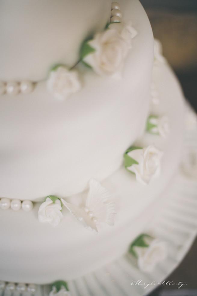 White wedding cake with roses. Grey White Farm Wedding, South Africa // Maryke Albertyn